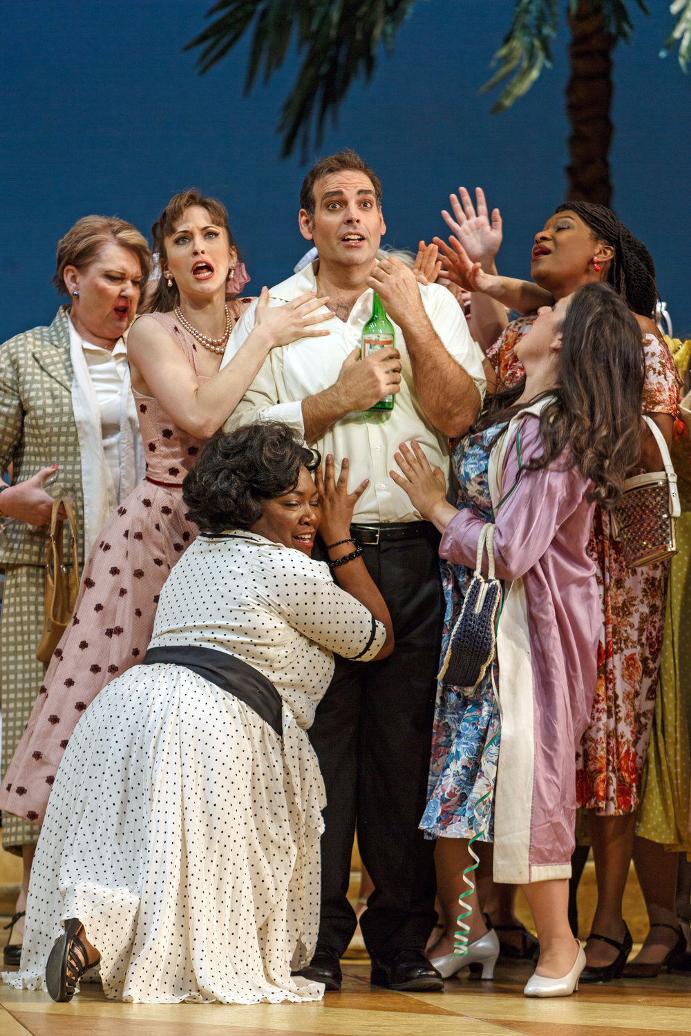 Giannetta (Shannon Jennings) and women fawn over Nemorino (Dmitri Pittas), who assumes the Elixir is working