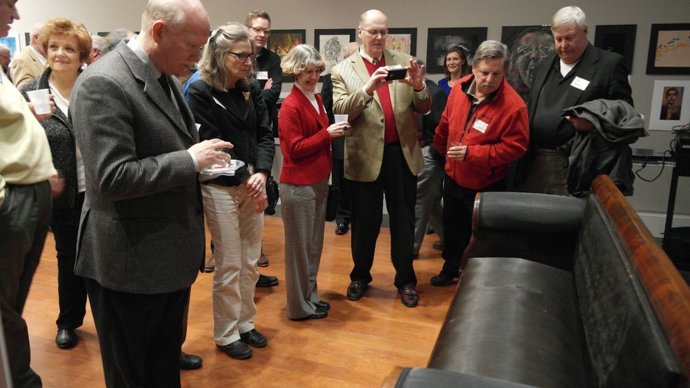 "Guests marvel the newly restored Lincoln ""Courting Couch"""