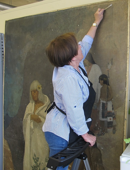"""Navaho"" being cleaned by Chief Conservator of Murals Dr. Margaret Nowosielska."