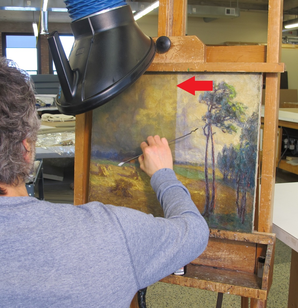 During Treatment - Note the cleaning line at the center of the painting.  Associate Paintings Conservator Rob Datum