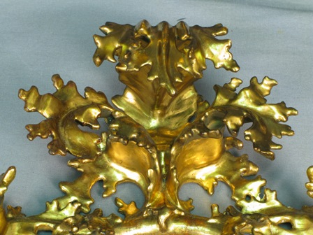 (Above) To finish the treatment, the newly gilded areas were toned to emulate the original finish