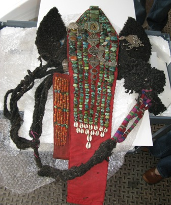 (Above) Before: Ladakhi Headdress made of fabric, felt, yak hair, colored wool, green and coral stones, silver, glue, and skin