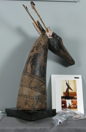 (Above) Pre-treatment: African antelope sculpture