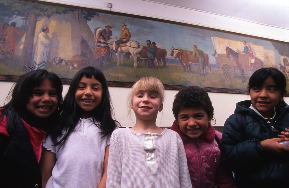 Pioneers and Indians, Datus E. Myers, 1920, oil on canvas, at Linné Elementary School with students.