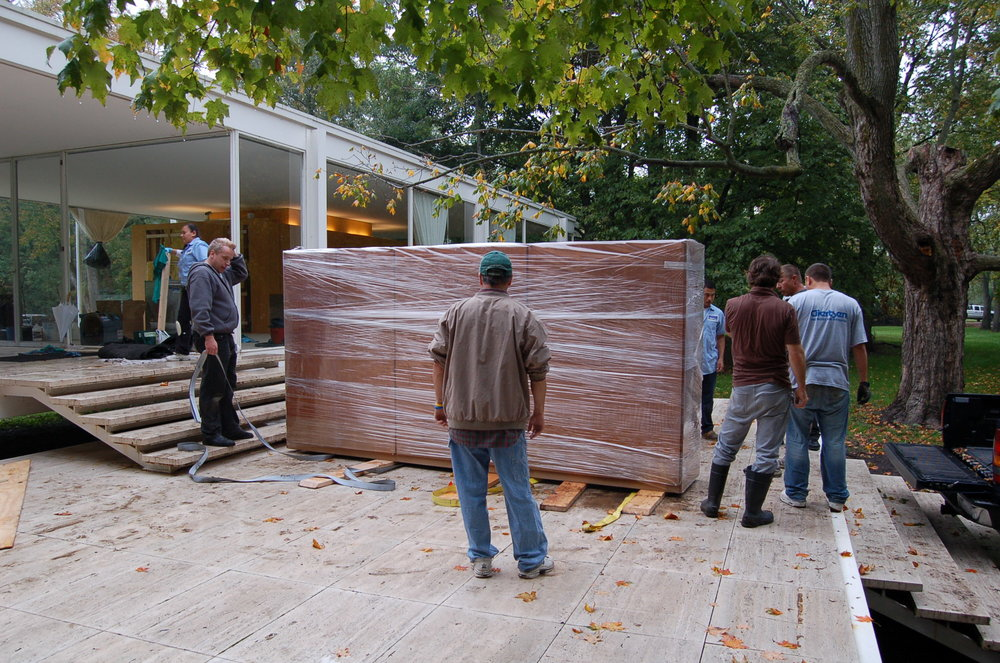 The Conservation Center's team transporting the wardrobe from the Farnsworth House to The Center. The wardrobe suffered severe water damage due to the flood.