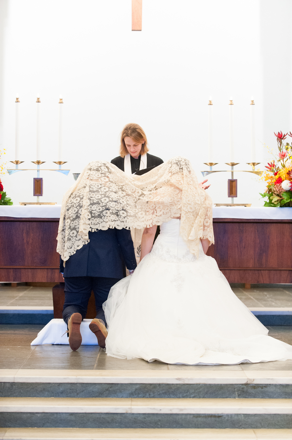 Pictured Above: Most recently, the mantilla was used in the wedding of Gloria's daughter Alexandra and her wife Kate in 2014.