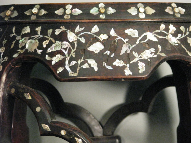 This pre-treatment image of a inlay occasional table clearly shows the recesses where mother-of-pearl fragments had been set.  Click here to learn more about the treatment of this table.
