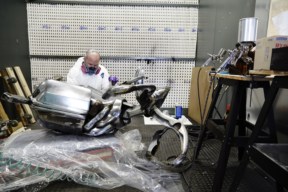 Conservator Andrew Rigsby in The Center's sealed treatment room, hard at work on the Ram sculpture.