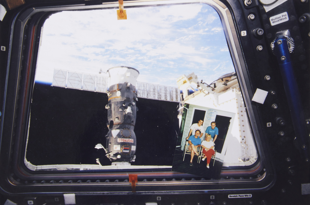 Family photo in the cupola, showing the best view from the International Space Station.