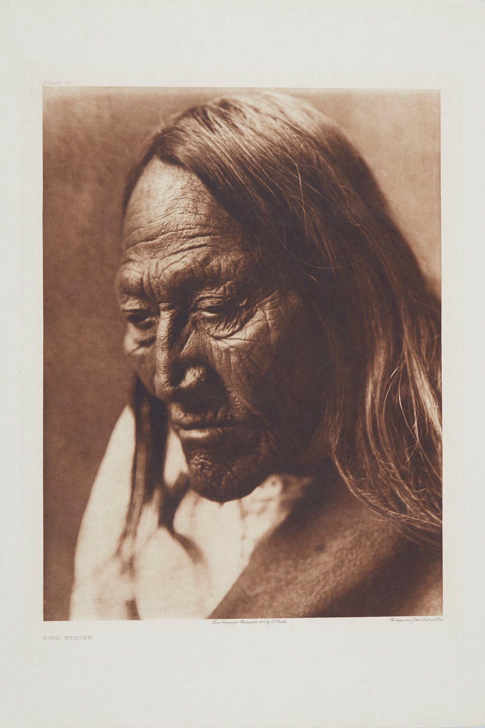Two Strike, Photogravure by Edward Curtis