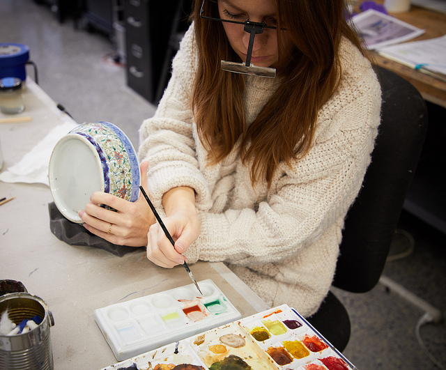 Sian inpaints the bowl with reversible paints.