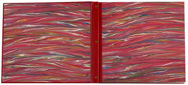 The Center designed the inside covers of the books to be lined with beautiful sheets of hand-made marbled paper.