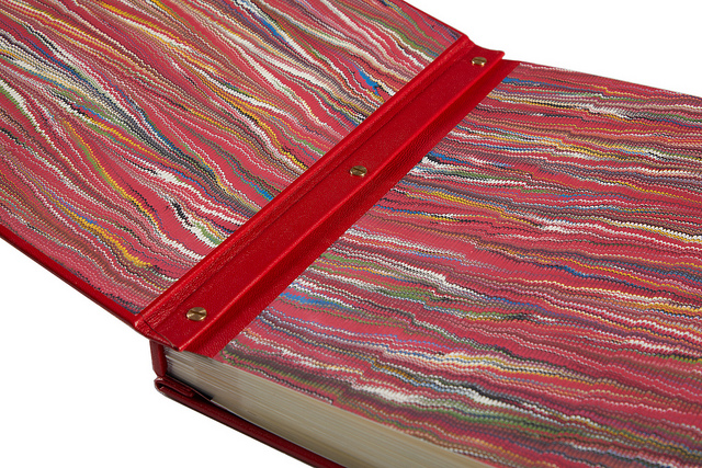 A detail showing the marbled paper and leather binding of Book I.