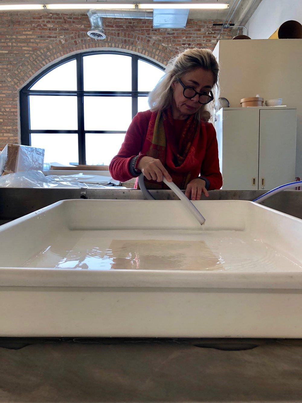 Senior Paper Conservator Bozena Szymanski water washes the print.