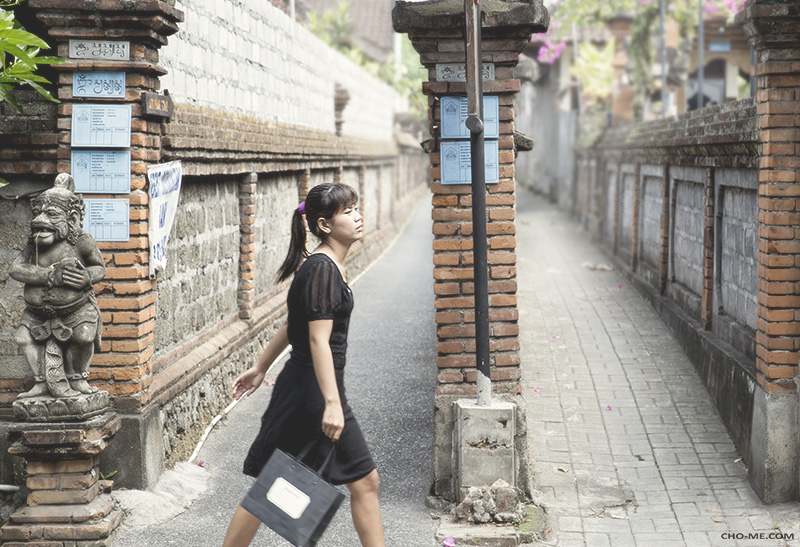GIRL CROSSING FROM ALLEY TO ALLEY