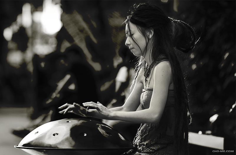 GET THE HANG OF IT  - Took this picture of a beautiful girl playing the instrument callSpacedrum / Hang in Orchard road Singapore.