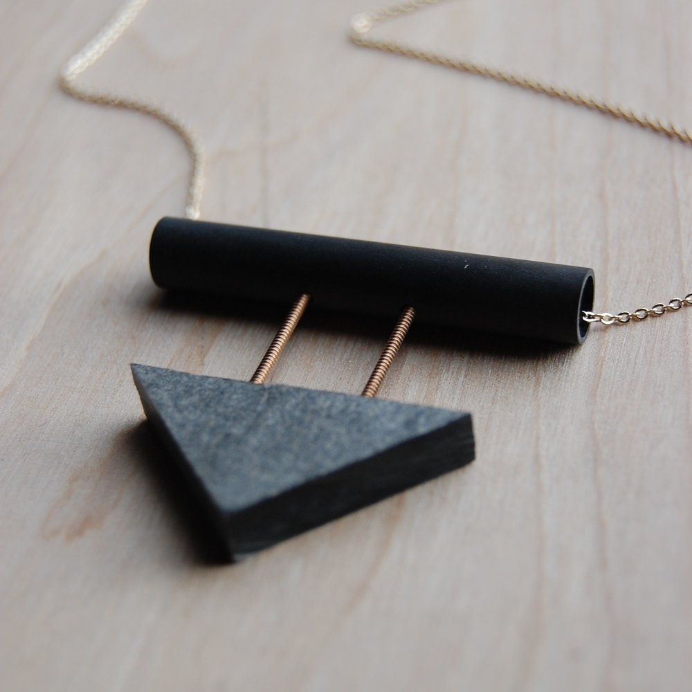 Jen Carlson Jen creates one of a kind jewelry often made from recycled materials. Her designs are bold, modern and graphic.