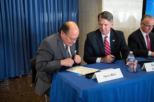 Aldridge CEO Steve Rivi signing the agreement