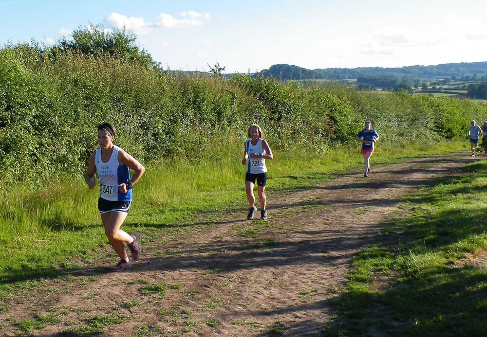 "ABBEYDORE WEDNESDAY 27th June 2018  Wye Valley Runners look forward to welcoming everyone back to  Abbeydore.  The course is best described as ""not flat"".  Race starts 7.30 prompt. Plenty of parking - with a short walk to start so please arrive in plenty of time.  Directions here  :  https://goo.gl/lBpsnI   Postcode for Sat Nav HR2 0JQ   A465 from Hereford to Abergavenny  Turn right opposite Wormbridge church, signposted Abbeydore  Continue and straight over crossroads to a T junction and then follow arrows from there"