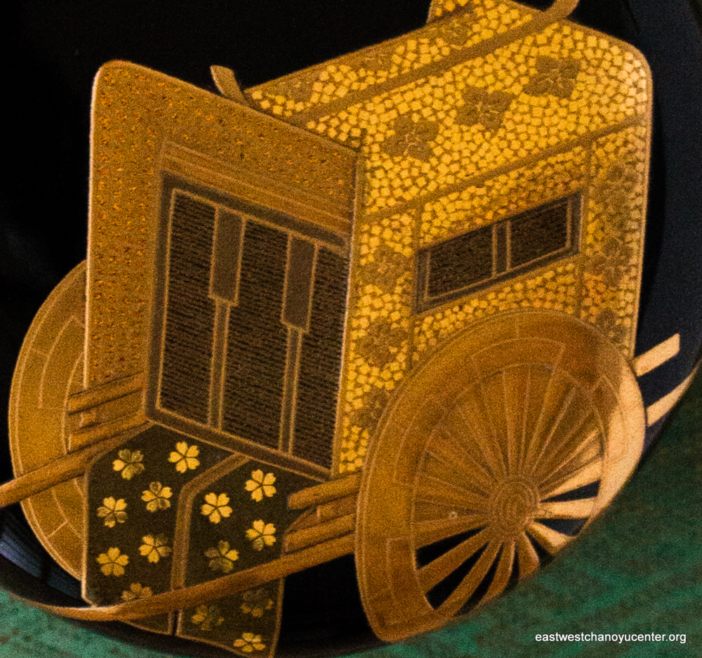 Lacquered tea container with design of Heian period ox-drawn cart in gold makie. The motif is commonly found on applied arts and calls to mind the Aoi Festival held annually in May in the ancient capital of Kyoto.