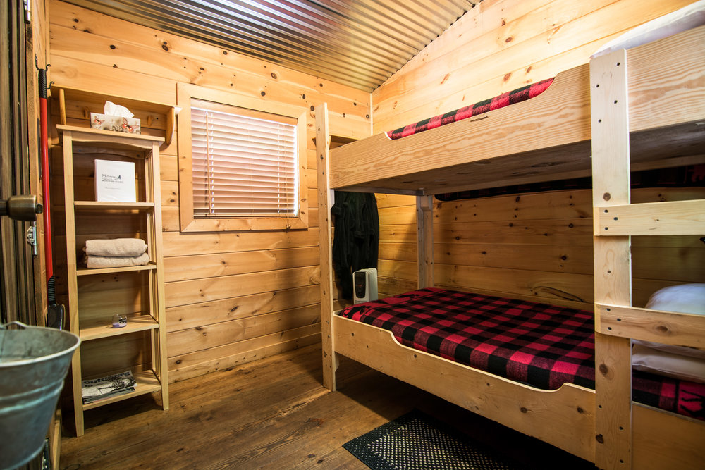 Dogwood Den - Previously: Cabin 3B. Sleeps 1-2. Perfect for individuals or friends. Turkey Run comes equipped with 1 bunk bed with top and bottom twin mattress.This cabin faces the babbling brook flowing through the property.