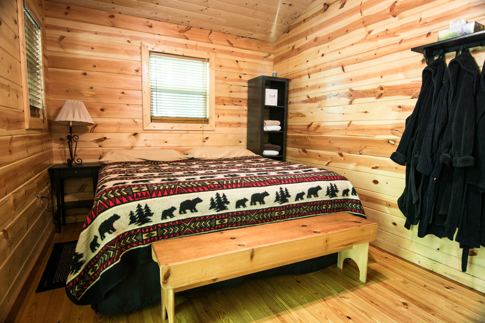 Trillium Meadow - Previously: Cabin 4B. Sleeps 2-4. Perfect for couples, families, or friends. Trillium Meadow comes equipped with one king bed and one bunk bed with top and bottom twin mattress. Hemlock Hideaway is near the campsites - great for groups who have mixed lodging but want to stay close.