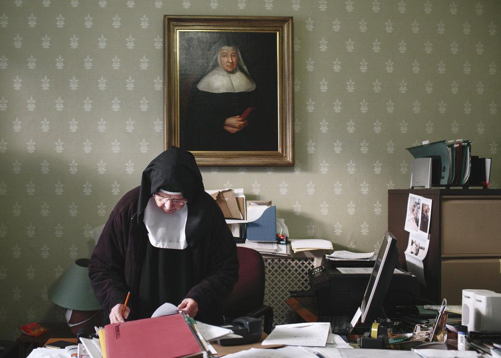 Mother Maire at desk.jpg