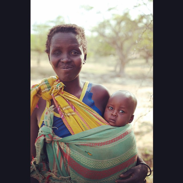 Look at that cute little bundle peeking out snuggled up with mom. While we were checking out potential water well sites a few locals would approach us out of curiosity. So we talked for a bit and I asked to take their group photo, after I took the group photo and they all laughed after seeing the back of my camera, this woman pulled me aside and asked (motioned) to have her picture taken again so that we could see her baby better. She was so proud to show off her little guy. Moms are the same all around the world. #proudmom #babywearing #moms #kenya #waterchangeseverything @hopewaterproject #weekofhope