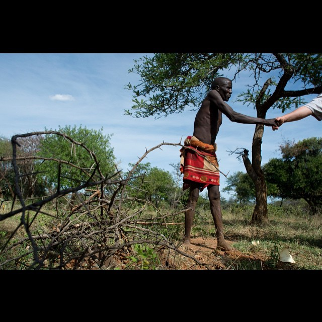 "I often hear the phrase ""we give people a hand up not a handout"".  And we believe that local empowerment is key to any program like this. Here a tribe leader from the Pokot region of Kenya shakes the hand of Jay who is partially responsible for this village getting water, a much needed basic necessity for life. In the foreground is a pile of thorny twigs that marks the spot a water surveyor said would be the best spot to drill for a new water well. The team gathered some information from him about schools in the area as well as churches and how many people live there. This well would serve anywhere between 2000 and 4000 people. Amazing! One well at a time.. #waterchangeseverything #cleanwater #cleanwaterwednesday @hopewaterproject #weekofhope #hopewaterproject"