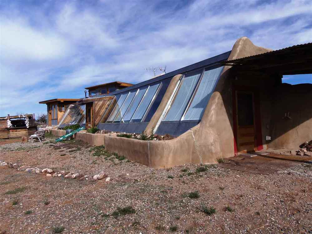 West Gorge Bridge - Earthship #96590   Enjoy quiet and peaceful off-the-grid living in this comfortable solar heated and solar photo-voltaic electricity powered green home. Located on the west side of the Tres Orejas ( 3 ears) mountain...( Find Out More )