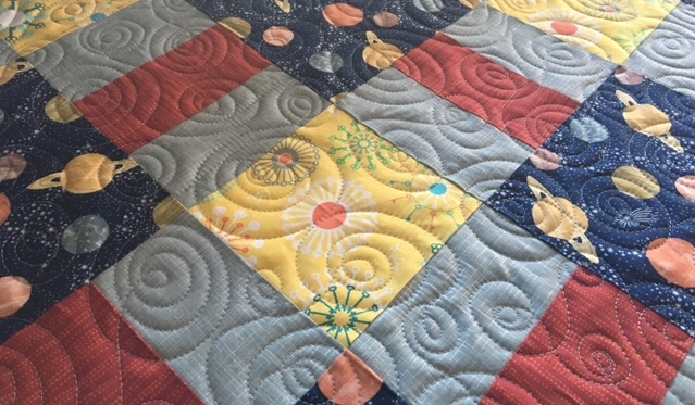 Grey Red Yellow Quilt.jpg