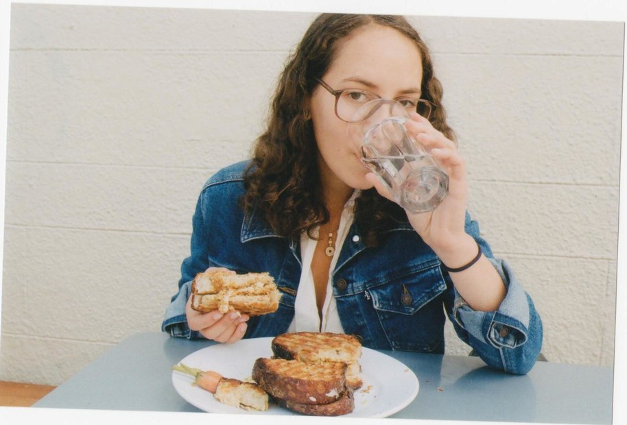 Photo of me at Tartine Bakery in San Fransisco in 2011 eating their pecorino and almond sandwich. (pic by  Jessica Chappe )