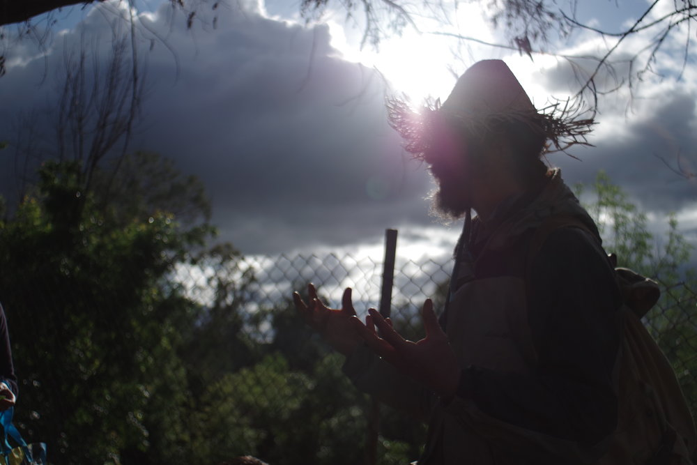 Joel with sun coming through his hat.  Photo by Alex Maloutas.