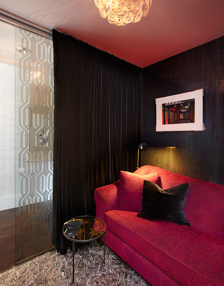 This sexy den incorporates black velvet drapes with a textured black wallcovering
