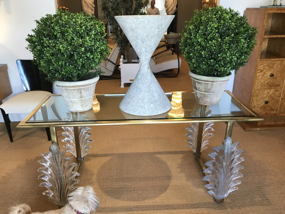 Honey also admires this amazing table with crystal legs!