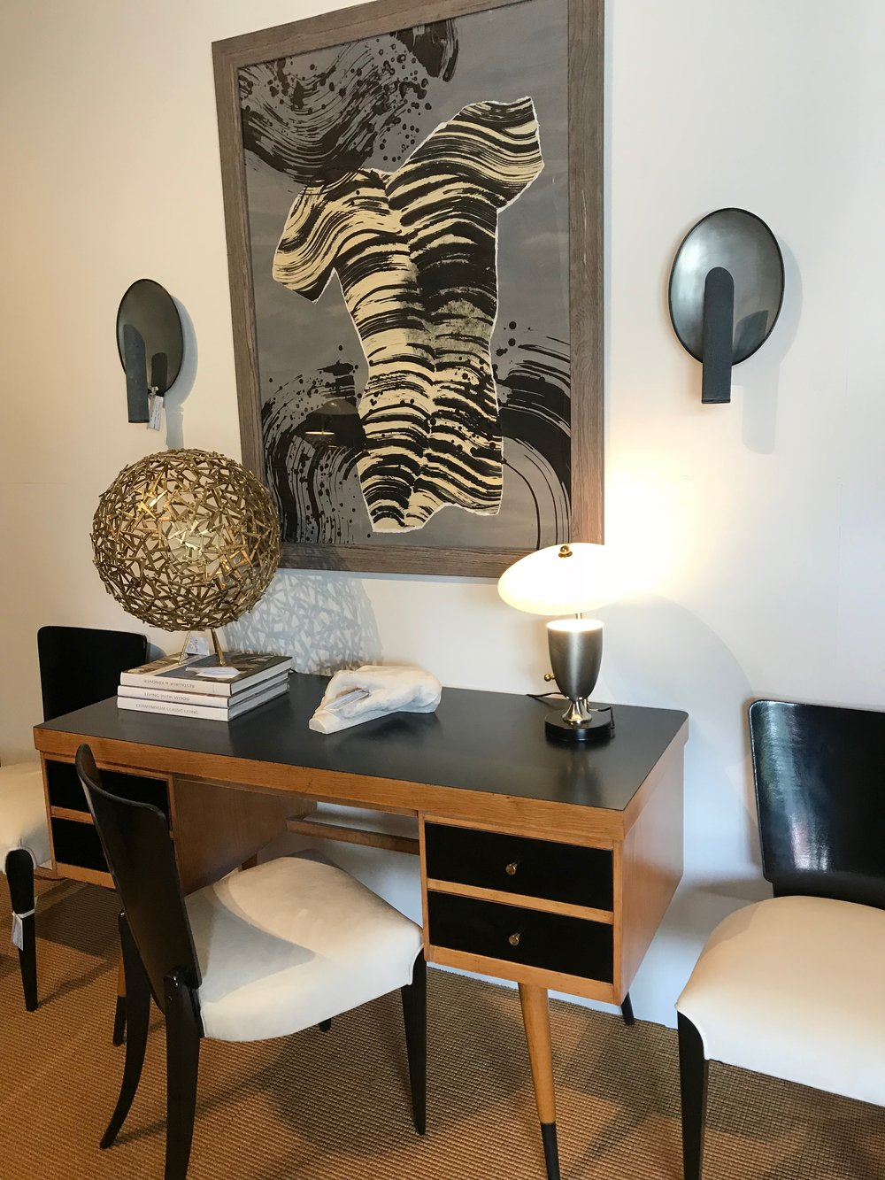 A desk, chair and art at Authentic Provence