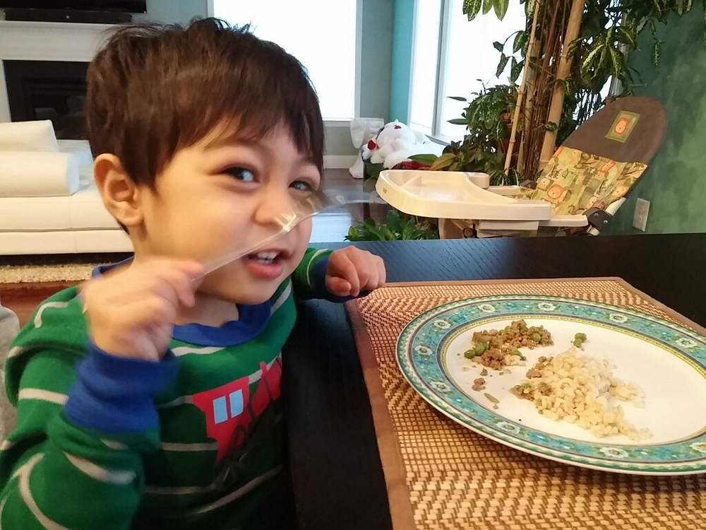 Constantine eating picadillo