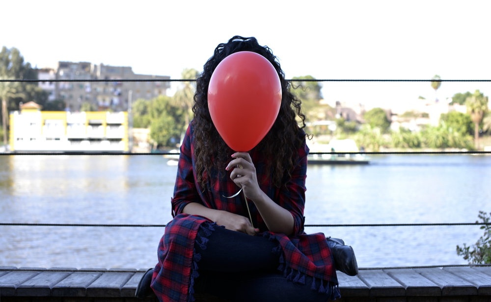 The Girl With the Red Balloon. Photo by Ahmed Najeeb