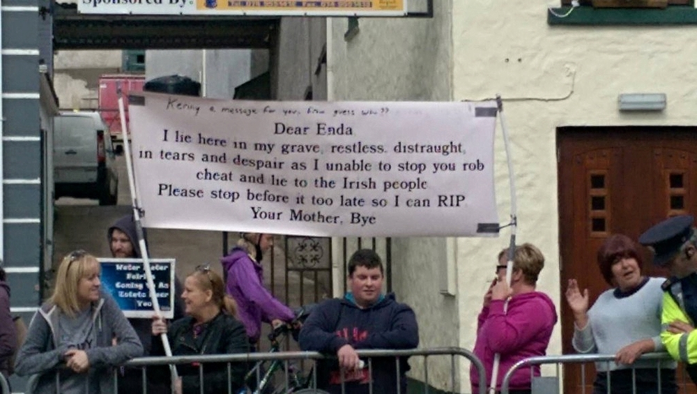 A poster unfurled by water protesters in Glenties yesterday evening has been described as 'disgusting' and 'deplorable.'