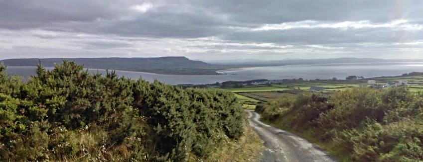 View of Greencastle and Lough Foyle with Magiligan Head in background