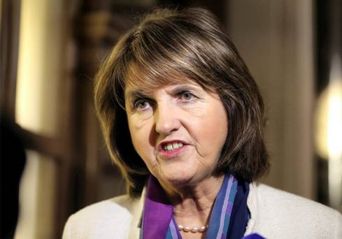 Labour's Joan Burton was left stranded in her car by protest. Photo: Frank McGrath