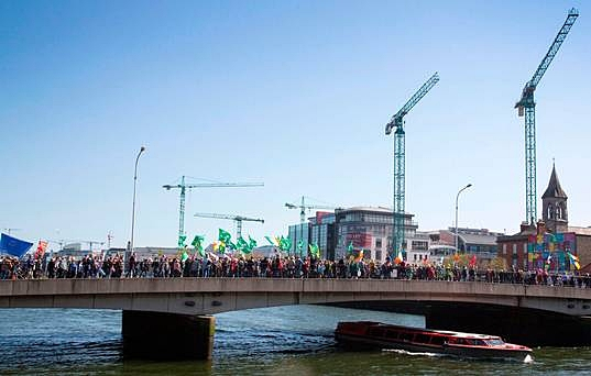 Protest: March against water charges crosses the Matt Talbot Bridge in Dublin yesterday.  Photo : Colin O'Riordan