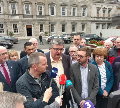Oireachtas Committee members Thomas Pringle, Ind, and Eoin Ó Broin SF, center, flanked by Right2Water TDs on the Dáil plinth on April 6th declaring a premature victory.
