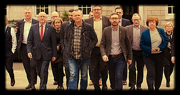 A group of R2W TDs predominately Sinn Féin,  heading to the Dáil plinth on April 6th.  At front Richard Boyd Barret, PBP, left and Eoin O Broin, SF, right