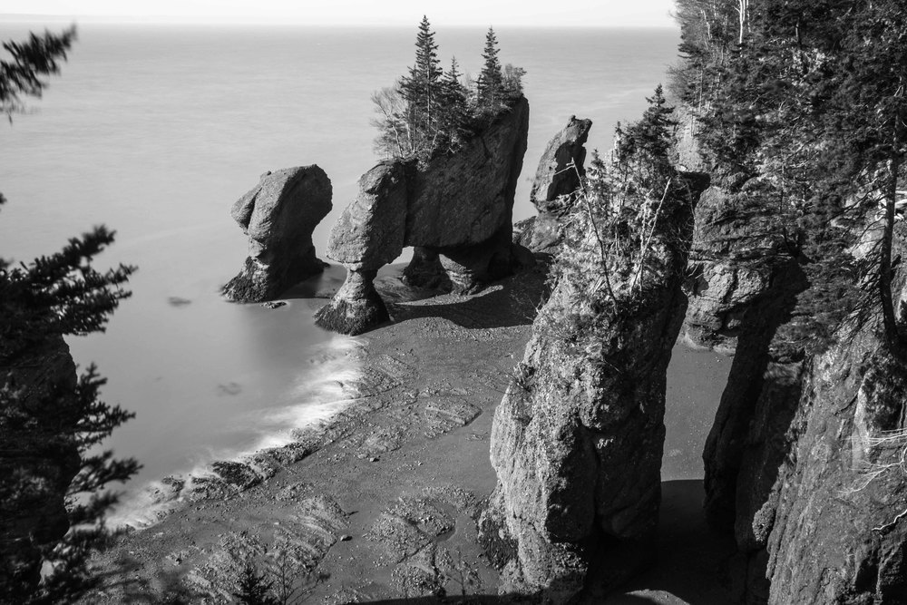 Black and white Hopewell rocks with ZERO tourist walking on the ocean floor.