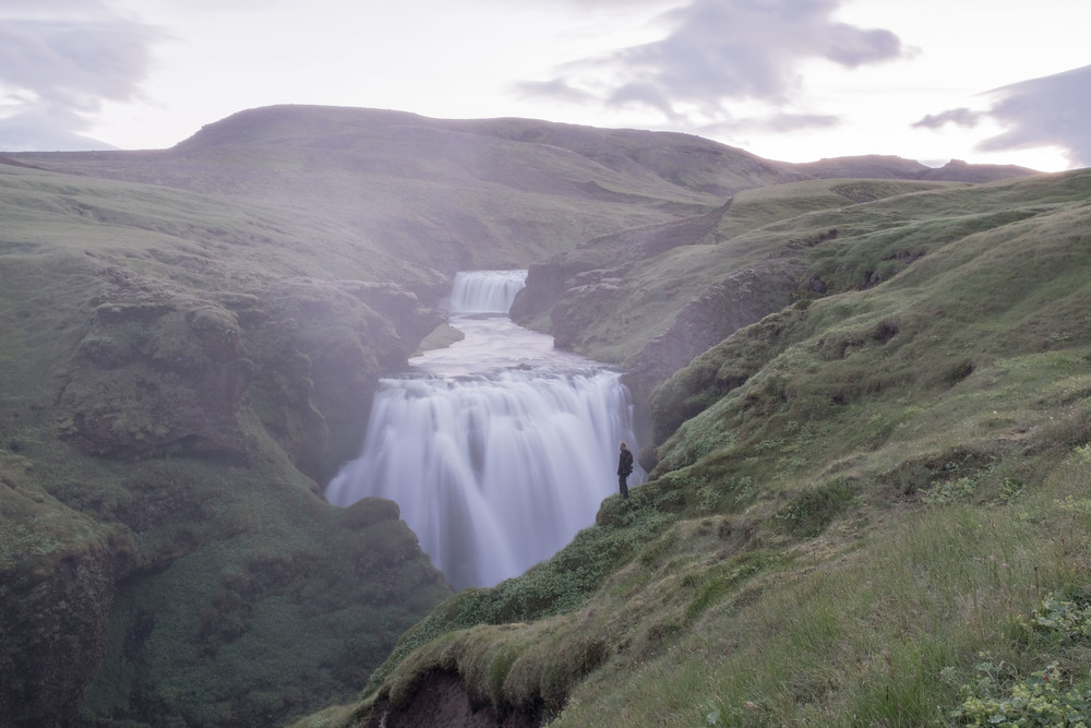 Photo of Joel Alston also known as BarefootandBearded admiring Iceland's beauty.