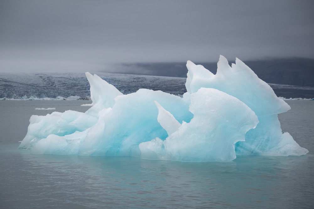 Iceberg floats in Iceland's Glacial Lagoon