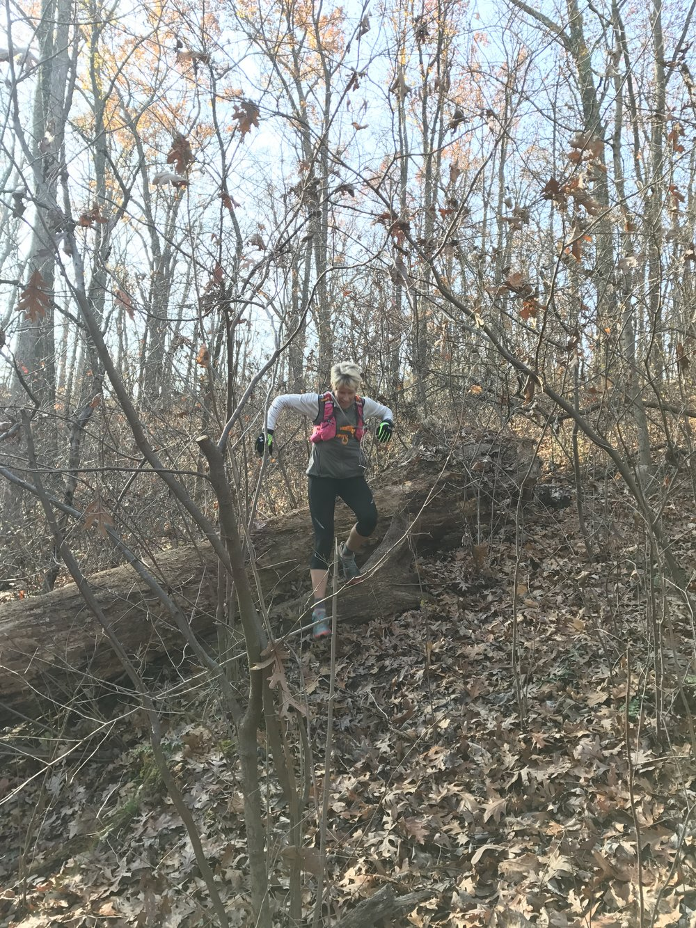 Tommy's wife Jenn jumping over a log crossing the Green Rock Trail Thanksgiving Weekend - Eureka, MO