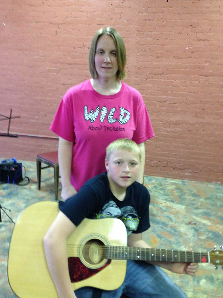 """""""We have been very pleased with the guitarlessons. Stuart is a very patient teacher, he works well with all ages. Thestyle of teaching that is used is well rounded and seems to work greatfor all learners. The materials are much easier to learn from and allow students to play actual songs much quicker. When my son first started learning from his guitar lessons book, he seemed to lose patience. This has been a great experience. and we definitely plan to continue!""""                                  -Stacey Power    """"I like how Stuart teaches the guitar lessons and how I can play my favorite songs a lot quicker. I am very glad I started taking his group lessons.""""                                  -CarsonPower"""