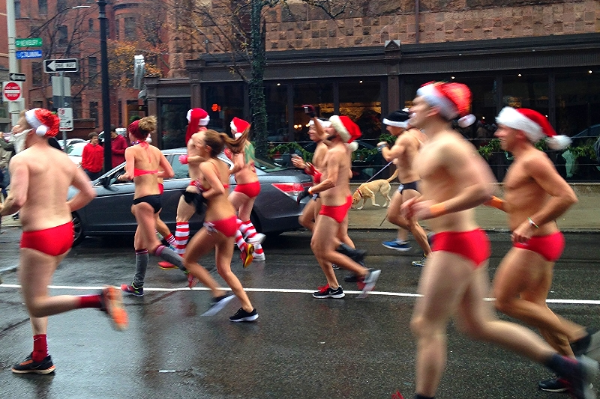 An atypical - and not particularly stylish - scene on Newbury Street:The Running of the Santas